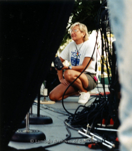 P119.075m.r.t San Diego Pride 1997: A woman kneeling with a professional camera