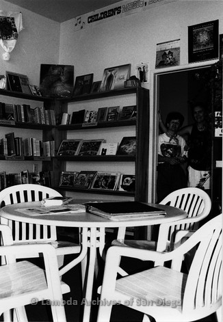 P167.095m.r.t Paradigm Women's Bookstore: Interior of bookstore with table and chairs in foreground and two women in background