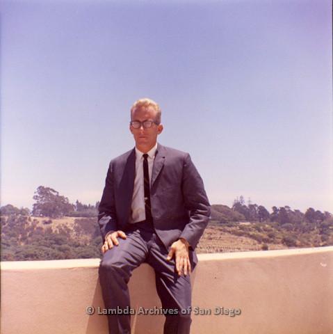 Jess Jessop sitting on a ledge outside of the San Diego US Naval Hospital, 1962