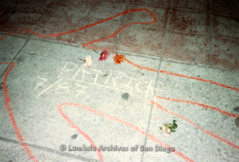 "P019.340m.r.t Los Angeles ""Die In"" 1988:  Red chalk outline of body on pavement, ""PATRICK 7/87"" written in middle"