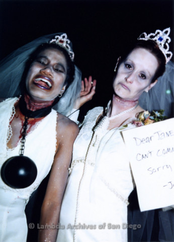 P184.047m.r.t Nightmare On Normal Street: Close up of two people dressed as dead brides