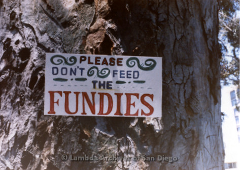 San Diego Lambda Pride Parade: Please Don't Feed The FUNDIES sign. Reminding Pride Parade attendees to ignore the Fundamentalist Christian Protesters.