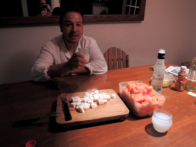 Isaac trying some Turkisk rakı and white cheese.  We didn't have melon, but papaya worked. by bryandkeith on flickr