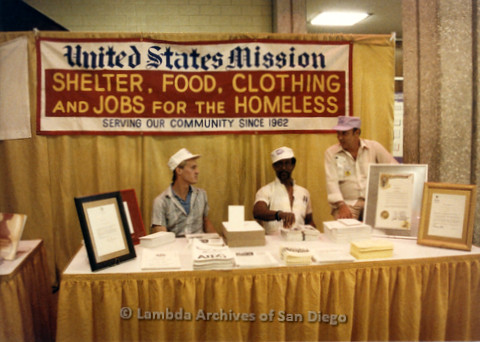 P019.198m.r.t AIDS Quilt at San Diego Golden Hall 1988: Three men sitting at United States Mission booth