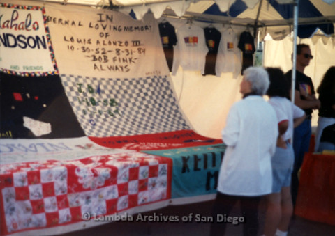 P197.024m.r.t AIDS Walk San Diego 1991: Two women looking at quilts set up at a booth