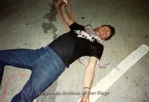 """P019.370m.r.t Los Angeles """"Die In"""" 1988:  Man laying on ground (Albert Bell?)with red chalk outline around him"""