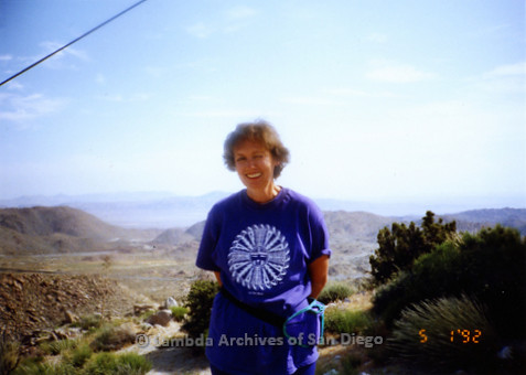 P167.001m.r.t Paradigm Women's Bookstore: Woman standing on a desert/mountain hiking trail
