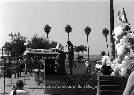 P116.030m.r.t San Diego Walks For Life 1986: Profile view of Susan Golding speaking at podium with Susan Jester behind her