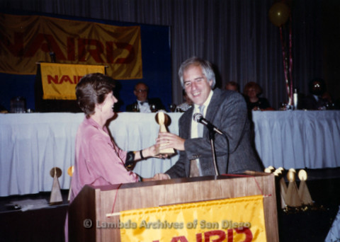 P168.005m.r.t National Association of Independent Record Distribution event: Karen Merry at podium presenting award to man in grey suit