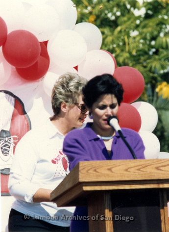 P116.007m.r.t San Diego Walks For Life 1986: Susan Golding speaking at podium with Susan Jester behind her