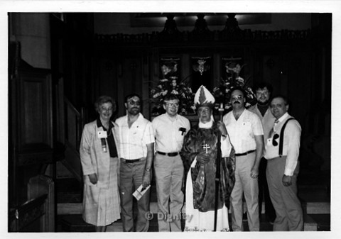 P107.005m.r.t Dignity/Canada/Dignite May 1986: Five men and a woman standing beside a priest