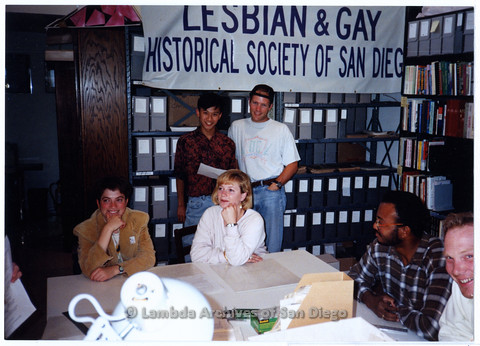 P200.016m.r.t UCSD student visitors sitting around table at Lambda Archives