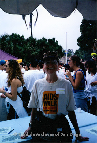 P199.018m.r.t LASD at 1997 AIDS Walk San Diego: Sharon Parker standing under a tent in AIDS Walk t-shirt