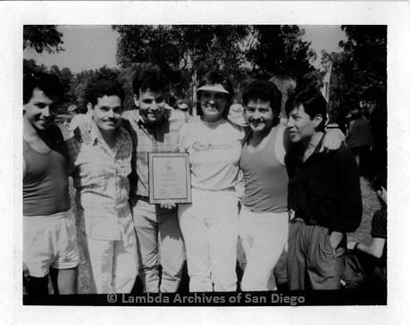 1986 - San Diego Lambda Pride Festival: Pride Parade Float Award Winners posing with their plaque.