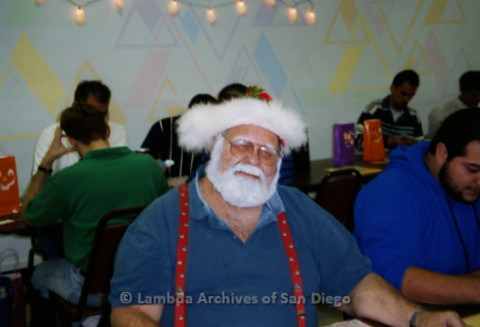 P240.063m.r.t The Center Halloween Bingo: Man playing Bingo dressed up as Santa Claus