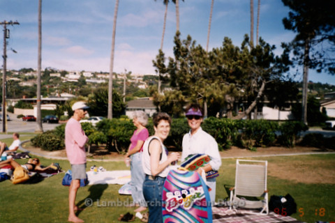 P239.039m.r.t Volunteer Picnic for The Center in La Jolla: People holding blankets and boogie board and smiling at camera