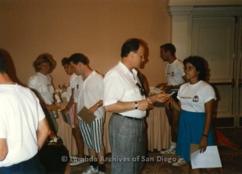 "P124.001m.r.t Multiple people indoors wearing ""San Diego Walks for Life 1988"" t-shirts"