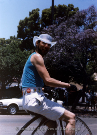 San Diego Lambda Pride Parade: Contingent Set Up Area, LGBTQ Community Activist, Mentor and Radical Faerie, Albert Bell riding an Old Fashion Bike in the Parade.