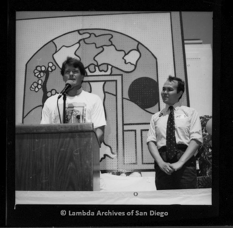P116.114.11m.r.t San Diego Walks for Life 1987: Gordon Thomson speaking at podium with Nicole Murray Ramirez to the right