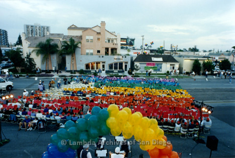 P234.043m.r.t SD Pride Rally: View of people creating rainbow with colored papers from on top of Normal Street Center