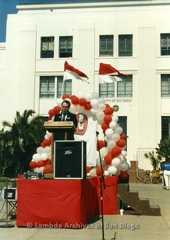 P012.004m.r.t San Diego Walks for Life 1986: Nicole Murray Ramirez speaking at podium