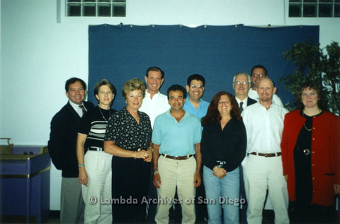 P237.014m.r.t Center Events: Group of people in front of blue backdrop