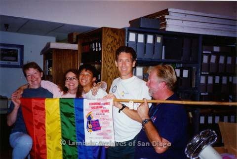 P018.130m.r.t San Diego Pride Festival 1994: Sharon Parker, Kate Johnson, Robert Nguyen, Frank Nobiletti, and Jim Oberle holding flag after clean up of exhibit