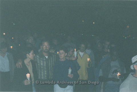 P236.002m.r.t Matthew Shepard Memorial at The Center 1998: Group of people holding candles