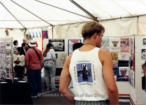 P018.055m.r.t San Diego Pride Festival 1990: Visitors walking around Lambda Archives booth