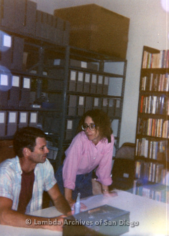 P199.011m.r.t Kate Johnson and Bruce Kamerling sitting at table inside Lambda Archives