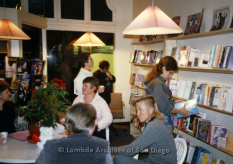 P169.065m.r.t Paradigm Women's Bookstore Grand Opening: Four women socializing at table, women browsing through books in background