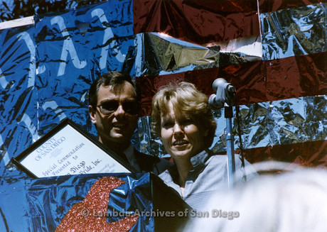 1985 - San Diego Pride Rally: Presentation of the County Proclamation by Neil Good (left) to Lambda Pride Board Chairperson Jay Sloan..