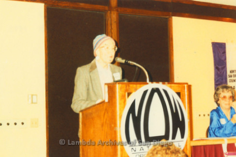 National Organization for Women, Susan B. Anthony Awards 1992: Ann Ramsey at podium on stage, with Gloria Johnson President of San Diego NOW sitting (right)