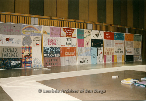 P019.023m.r.t AIDS Quilt at San Diego Golden Hall 1988: Display of multiple quilts along wall