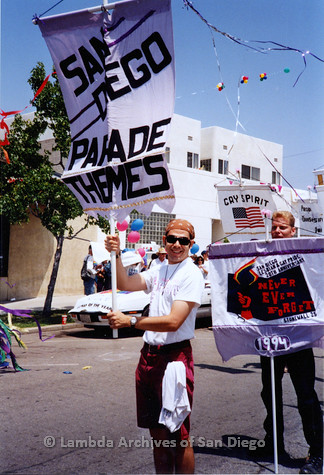 P018.119m.r.t San Diego Pride Parade 1994: Jake holding Lesbian and Gay Archives banner