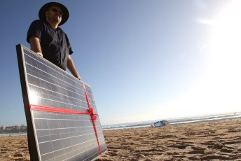 Solar panel gift on Manly beach as Common Grace ask PM Tony Abbott to #acceptthegift of solar for Kirribilli House