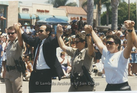 1995 - San Diego LGBT Pride Parade: San Diego Law Enforcement Contingent, Judge David Rubin (center) Surrounded by Two Out LGBT Police Officers.