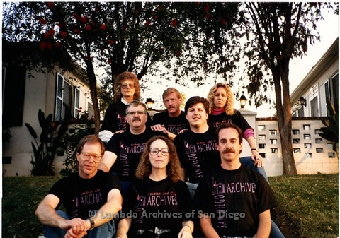 1990 - Members of the original Lambda Archives San Diego planning committee in front of Jess Jessop's apartment. Front row left - right: John Richardson, Kate Johnson, Frank Shine, middle row l-r: Doug Moore, Rodney Jaeger. Back row l-r: Kay Jordan, Jim G