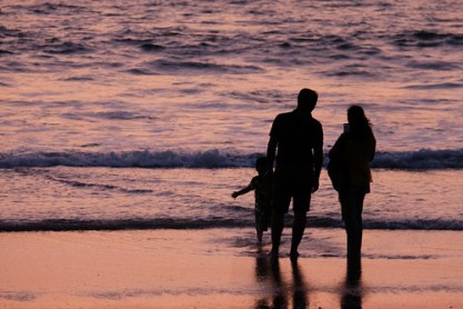 Silhouettes of a Family Watching Sunset on the Beach