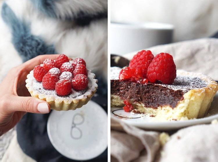 Gluten free chocolate tarts with a homemade gluten free sweet shortcrust pastry, dark chocolate and fresh raspberries on top