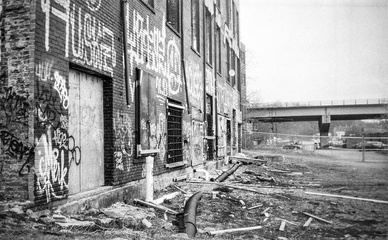 abandoned warehouse, junk-strewn grounds, fences, overpass, River District, Asheville, NC, Eastman Kodak No. 2 Bulls Eye Model D, Foma Retropan 320, HC-110 developer, 4.4.19