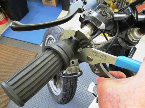 Loosening Left Handlebar Grip Assembly