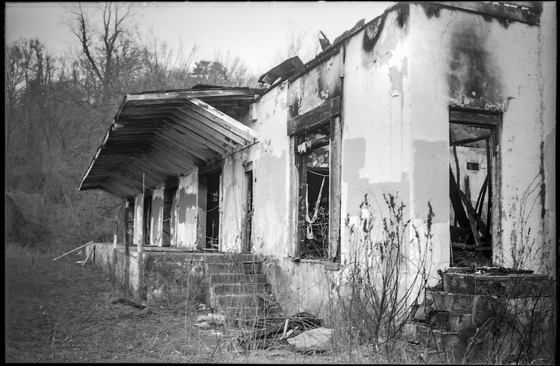 burned-out commercial building III, loading dock, doors and stairways, Asheville, NC, Minolta Freedom Dual 60, Kodak TMAX 400, Ilford Ilfosol 3 developer, 3.13.19