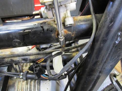 Removing Front Brake Line Manifold Steel Strap