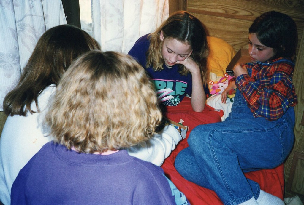 friends playing cards in a camper