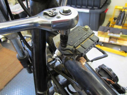Remove Ignition Control Module From Top of Front Brake Line Splitter-Manifold