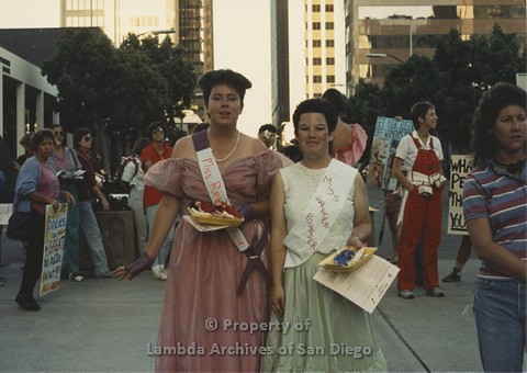 P024.110m.r.t Myth California Protest, San Diego, June 1986: two girls wearing sashes (from left to right: Miss Represented, Miss Quarter Pounder)