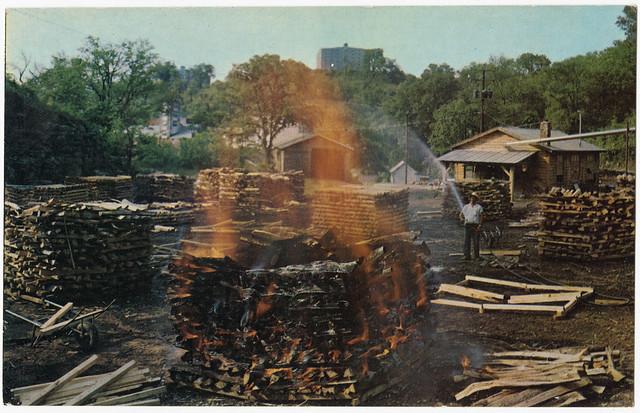 Making charcoal at Jack Daniel's, Jack Daniel Distillery, Lynchburg (pop. 361), Tennessee
