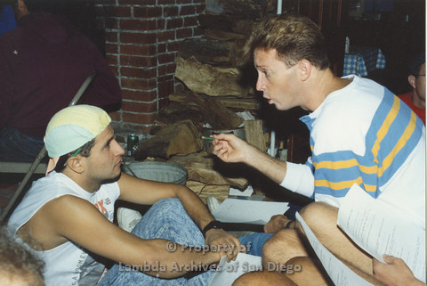P001.226m.r.t Retreat 1991: 2 men talking near fireplace