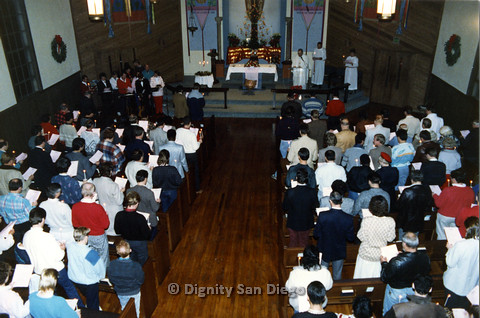 P103.020m.r.t Dignity San Diego, Christmas 1988:  Whole church congregation reading white paper
